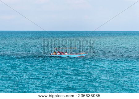 A Small Boat Floats On The Sea. Beautiful Sea Landscape. Fishermen Are Going In The Sea For Fishing