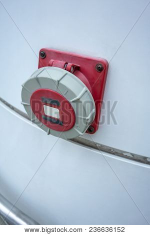 Hose Valve For Fire Protection Equipment Mounted From Building. White Wall With Red Splitter Hose Co