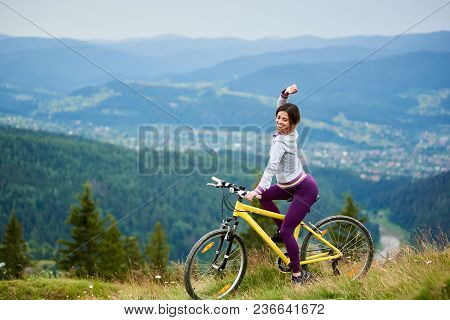 Beautiful Female Cyclist Posing On Yellow Bicycle In The Mountains On Summer Evening. Mountains, For