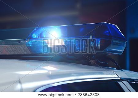 Police At Night In The Car With Blue Siren Flasher. Siren On Police Car Flashing, Close-up. Police L