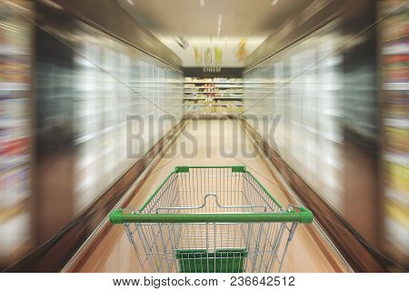 Supermarket Aisle With Empty Shopping Cart, Supermarket Store Abstract Blurred Background With Shopp