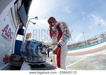 April 06, 2018 - Avondale, Arizona, USA: Tony Kanaan (14) prepares for a practice session for the Desert Diamond West Valley Casino Phoenix Grand Prix at ISM Raceway in Avondale, Arizona.