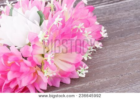 Colorful Fabric Flowers On Wooden Background, Closeup Picture.