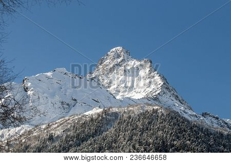 Snowy Mountain Peak. Caucasian Mountains. The Mist Over The Top