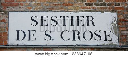 Road Sign That Means Saint Crux District In Italian Language In Venice Italy. The Name Sestier Means