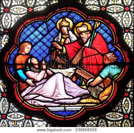PARIS, FRANCE - JANUARY 05: Recognition of the true Cross among the three discovered, stained glass window in the Basilica of Saint Clotilde in Paris, France on January 05, 2018.
