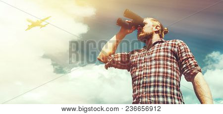 Adventure Search Concept Man Traveler Looking Through Binoculars In The Distance Against The Sky. Lo