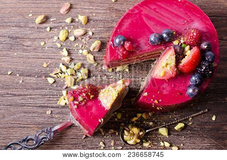 Piece Of Delicious Raspberry Cake With Fresh Strawberries, Raspberries, Blueberry, Currants And Pist