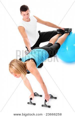 A picture of a young woman working out with her personal trainer over white background