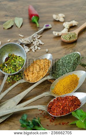 Various Spices In  Spoons On The Wooden Table,powdered Red Pepper, Mint, Zahter, Peanut, Cumin, Ging