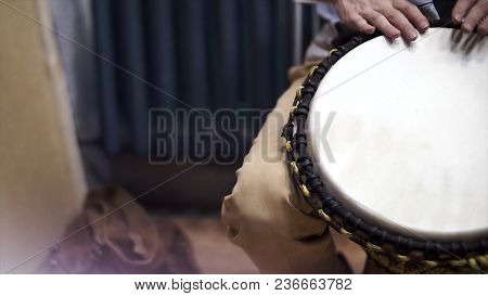 Close Up Of Hands Of A Black Man Playing A Drum. Drummer Plays On Small African Drum, Closeup Photo