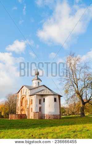 Paraskeva Pyatnitsa Church At Yaroslav Courtyard In Veliky Novgorod, Russia. Autumn Architecture Lan