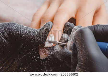 Master Of Manicure Removes An Automatic Typewriter Layer Of Old Nail Polish With A Woman.