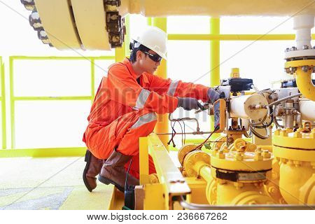 Electrical And Instrument Worker Inspect And Checking Voltage And Current Of Electric System At Oil