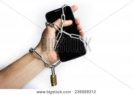 Hand And Smartphone Are Connected With An Iron Chain With Lock On White Background. Social Media And