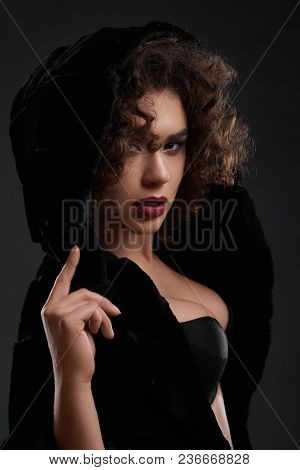 Passionate Curly Girl Posing In Black Jacket And Bra. Looking Very Sexy And Beatiful. Wearing Light