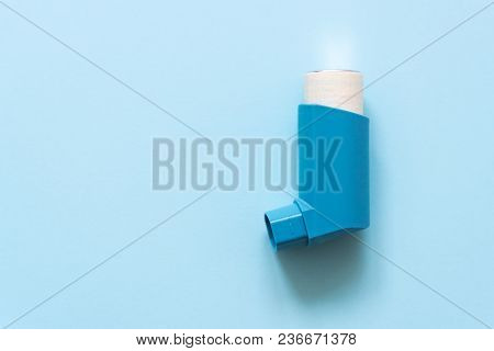 Aerosol For Inhalation For The Treatment Of Bronchial Asthma On A Blue Pastel Background.