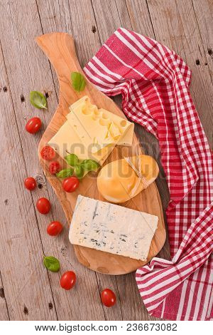 Various Type Of Italian Cheeses On Cuttingborad.