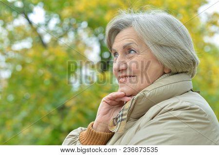 Portrait Of Beautiful Senior Woman Posing  In  Park