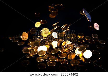 Falling Gold Coins Money In Dark Background, Business Concept.