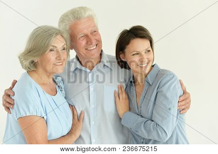 Close Up Family Portrait Of Happy Parents With Adult Daughter Posing Together