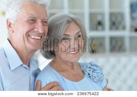 Close Up Portrait Of Happy Mature Couple At Home