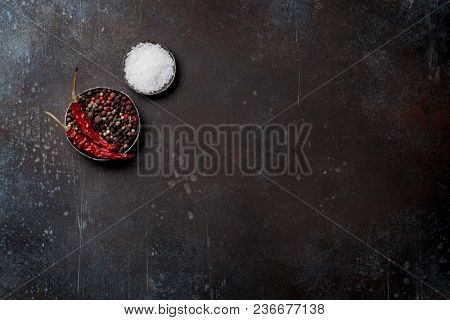 Spices over stone table. Salt and pepper. Cooking concept. Top view with space for your text