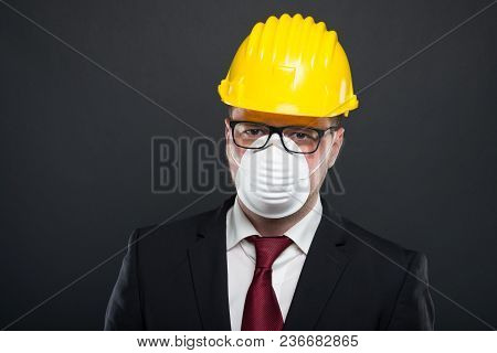 Business Young Man Wearing Hardhat And Protection Mask.