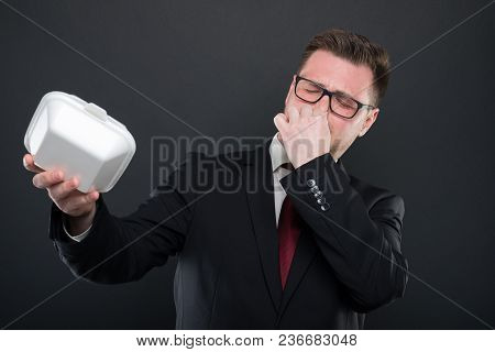 Business Man Covering Nose From Bad Smelling Lunchbox.