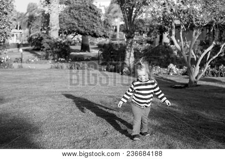 Child In Blue Clothes Play On Sunny Day. Activity, Experience, Learning. Summer Vacation, Adventure,