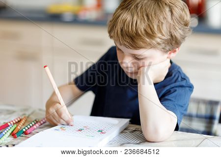 Tired Sad And Drepressed Little Kid Boy At Home Making Homework At The Morning Before The School Sta
