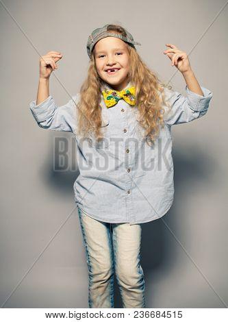Dansing child. Motions fashion girl studio shot