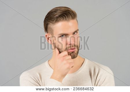 Bearded Man Touch Beard With Hand. Macho With Stylish Hair And Healthy Young Skin. Guy With Unshaven