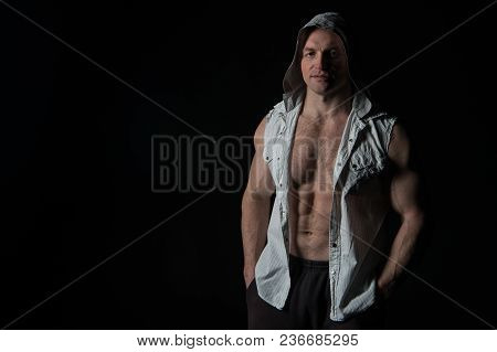 Man Athlete Wear Hood. Bodybuilder With Fit Torso Muscles. Sportsman Show Biceps And Triceps In Slee