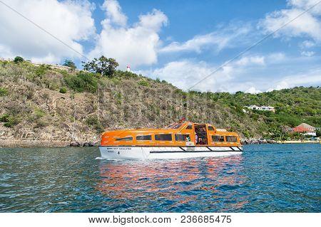 Gustavia, St.barts - November 25, 2015: Ship Travel In Blue Sea Along Seashore. Water Transport And