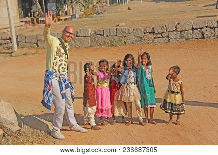 India, Hampi, 02 February 2018. A Bald And Cheerful European Man With Children From India. Hampi, Vi