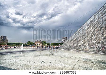 Paris, France - June 02, 2017: Courtyard Of Louvre Museum With Glass Pyramid And People Queue On Clo