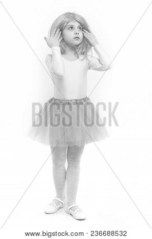 Small Girl T In Pink Skirt. Beauty And Fashion. Childhood And Happiness. Child In Wig Isolated On Wh