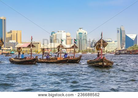 Dubai, United Arab Emirates - May 3, 2013: A Traditional Dhow Ferries Along Dubai Creek. The Creek D