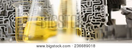 Test Tube Chemistry Flask Against Background Of Hydroblock Acp With Yellow Liquid Purified Oil From