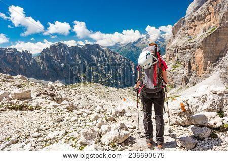 Female Trekker Walking Along Mountain Valley. Trekking Brenta Dolomites, Sentiero Delle Bocchette Al