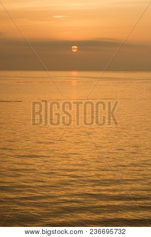 Orange View Of Gentle Sea At Sunrise In Vertical Composition