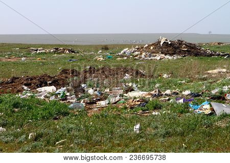 Garbage Piles In Trash Dump Or Landfill In Green Field.