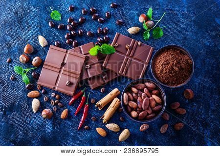 chocolate pieces crushed and cocoa beans culinary background - sweet food