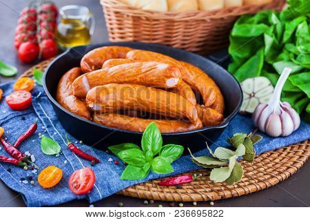 lots of bbq sausages with vegetables on the table - food and drink