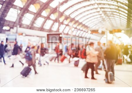 Blurred Crowd Of People With Suitcases At The Train Station. Passangers In Motion.