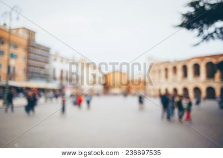 Blurred Backgound Of Old City. Crowd Of People In Verona.