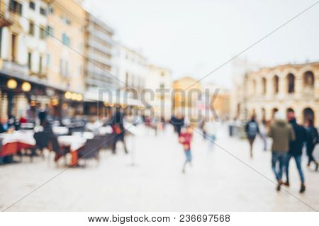 Crowd Of People Walking In The City Square, Blurred Backgound.