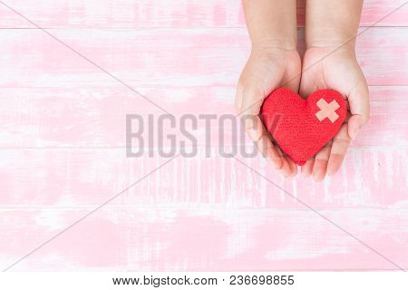 World Health Day, World Malaria Day, Healthcare And Medical Concept. Woman Hand Holding Handmade Red