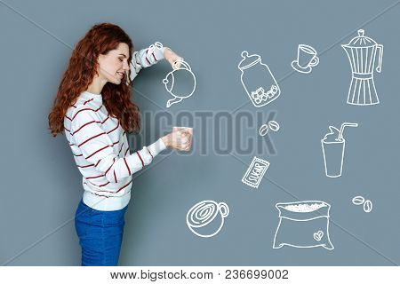 Cheerful Waitress. Professional Skilled Waitress Looking Calm And Friendly While Pouring Hot Tea